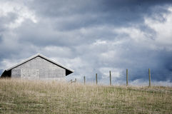 Farm in the storm Stock Photo