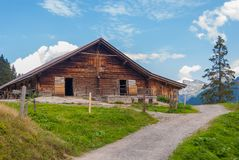 Farm in summer in the Swiss Alps. Farm in the alpine mountains in Switzerland stock images