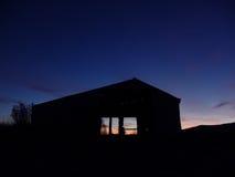 Farm Sunrise. Sunrise behind barn Stock Photo