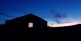 Farm Sunrise Panoramic. Sunrise behind barn - Panoramic Stock Image
