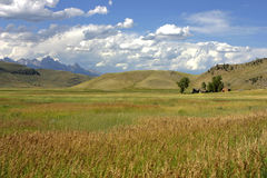 Farm with the Teton Range in the background Royalty Free Stock Image