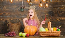Farm themed games and activities for kids. Girl kid at farm market with fall harvest. Child little girl celebrate royalty free stock images