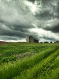 Farm and threatening stormy sky Stock Photos