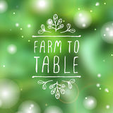 Farm to table - product label on blurred Stock Images
