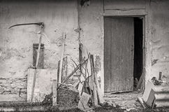 Farm tools near wall of old shed Royalty Free Stock Images