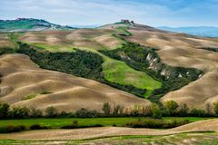 Farm on top of the hill. In Tuscany royalty free stock image