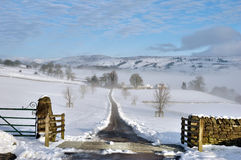 Farm Track Leading Through Snow Royalty Free Stock Image