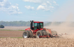 Farm Tractor. Plowing the field before planting stock photos