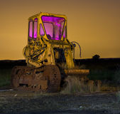 Farm tractor. Old farm tractor at a dumping ground with star trails at night Stock Photo