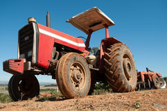 Farm Tractor. Vintage Tractor with plowshare in a farm Stock Image