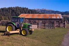 Farm tractor. The farm tractor is used for pulling or pushing agricultural machinery or trailers royalty free stock image