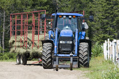 Farm tractor. A parked farm tractor and trailer royalty free stock photography