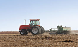 Farm Tractor. Discing a field after harvest royalty free stock image