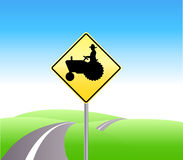 Farm tractor crossing caution Royalty Free Stock Photo