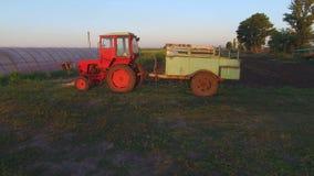 Farm tractor in a field stock footage