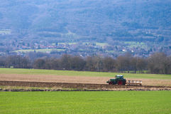 Farm tractor in field Stock Photography