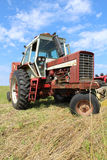Farm Tractor in Field Royalty Free Stock Photo