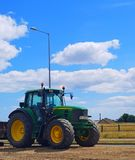 Farm Tractor. A Green farm tractor with yellow wheels Stock Photo