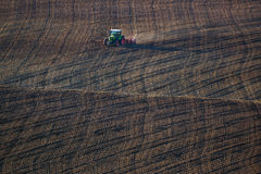 Farm Tractor Handles Earth on Field Stock Images