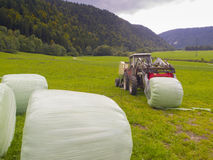 Farm Tractor and Hay Bales Royalty Free Stock Images