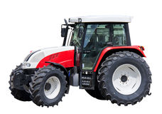 Farm tractor isolated. A farm tractor isollated on white background royalty free stock photo