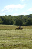 Farm Tractor Making Hay Royalty Free Stock Photo