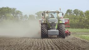 Farm tractor moving on agricultural field. Agricultural equipment stock footage