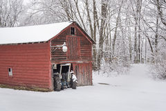 Snow on a Country Morning. A Farm tractor pokes out of the barn after an early morning snowfall in Rotterdam, New York Stock Photography