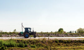 Farm Tractor. On the road Stock Images