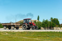 Farm Tractor. On the road Stock Photography