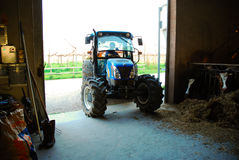 Farm tractor in rural area royalty free stock photo