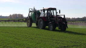 Farm tractor spray autumn  green crop field Stock Images