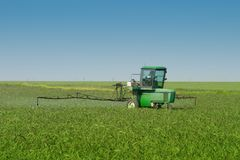 Farm Tractor Sprayer In Field Stock Photo