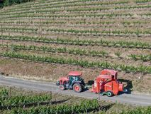Farm tractor spraying pesticides & insecticides herbicides over green vineyard field. Napa Valley, Napa County, California, USA stock photography