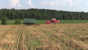Farm tractor work in village field. stock footage