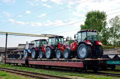 Free Farm Tractors Loaded On A Freight Train. Import/export Of The Agriculture And Farming Equipment. Royalty Free Stock Photo - 161783945
