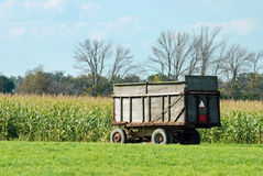 Farm trailer by a corn field Stock Photo