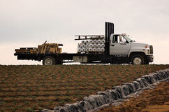 Farm Truck. A farmer's truck loaded with rolls of plastic for the strawberry fields stock photos