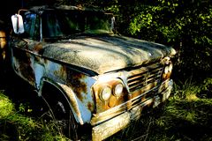 Farm Truck. Old rusty truck abandoned in a field royalty free stock photography