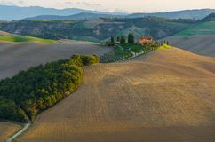 Farm in Tuscany. Sunrise over a scenic farm in Tuscany royalty free stock image