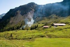 Farm in Tyrol. Alpine landscape in Tyrol with a milk farm Royalty Free Stock Photo