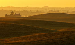 The farm on undulating fields of autumn Stock Image