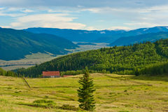 Farm in the Valley. Unique little farm in the san juan mountain range and the valley below royalty free stock image