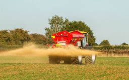 Farm Vehicle spreading lime sandstone onto a field Royalty Free Stock Image
