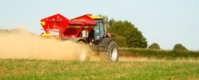 Farm Vehicle spreading lime onto a field Stock Images