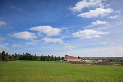 Farm view with big blue sky Royalty Free Stock Image