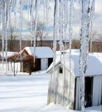 Farm view through icicles Stock Photo