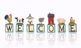 Farm Welcome Sign Over White Stock Images