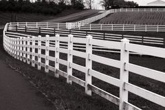 Farm white fence in black and white Royalty Free Stock Photos