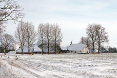 Farm in a white winter landscape Royalty Free Stock Image